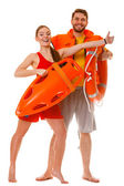 Lifeguards showing thumb up gesture — Stock Photo