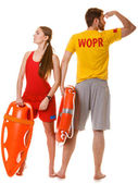 Lifeguards with rescue tube — Stock Photo
