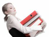 Businesswoman holding stack of folders — Stock Photo
