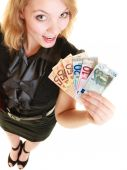 Woman showing euro currency — Stock Photo