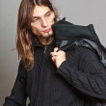 Man holding coat — Stock Photo #79183126