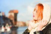 Girl in warm clothing enjoying sunlight — Stock Photo