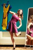 Woman shopper looking in mirror — Stock Photo