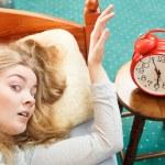 Woman waking up turning off alarm clock — Stock Photo #80086308