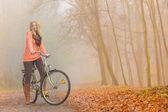 Girl relaxing riding bike bicycle — Stock Photo