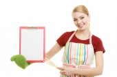 Housewife holding clipboard — Stock Photo