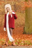 Fashion woman in windy fall autumn park forest. — Stock Photo