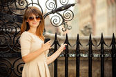 Fashion girl with smart phone outdoors — Stock Photo