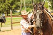 Western cowgirl woman with horse. Sport activity — Stock Photo