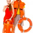 Man and woman supervising swimming pool — Stock Photo #83524554