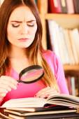 Woman holding magnifying glass — Stock Photo