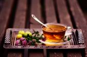 Herbal Tea with clover and green apples — Stock Photo