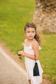 Little girl on nature — Stock Photo
