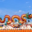 Golden Dragon against Blue Sky Background, Close-up — Stock Photo #56928121