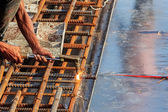 Welder in Cutting steel bar — Stock Photo