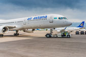 Air Astana Airplane Being Towed to a Gate — Stock Photo
