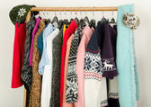 Close up on wardrobe with winter clothes nicely arranged. — Stock Photo