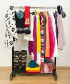 Wardrobe with winter clothes nicely arranged. — Stock Photo