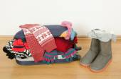 Winter luggage. Suitcase full of wither clothes. — Stock Photo