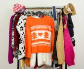 Cute sweaters displayed on a rack. — Stock Photo