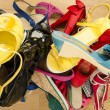 Close up on big pile of colorful woman shoes. — Stock Photo #53841895