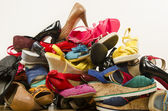 Close up on big pile of colorful woman shoes. — Stock Photo