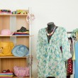 Wardrobe with summer clothes nicely arranged and a beach outfit on a mannequin. — Stock Photo #62825239