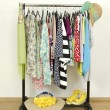 Wardrobe with summer clothes nicely arranged.  — Stock Photo #62825241