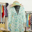 Wardrobe with summer clothes nicely arranged and a beach outfit on a mannequin. — Stock Photo #62825251