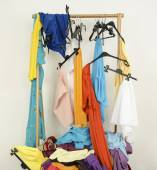 Messy rack of clothes and hangers.  — Stock Photo