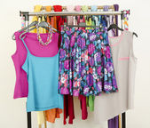 Cute summer outfits displayed on a rack.  — Stock Photo