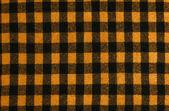 Крупный план на пестрой шерстяной ткани скатерти. — Стоковое фото