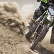 Motocross racer accelerating speed in track — Stock Photo #75796841
