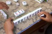 People playing mahjong on street, Yunnan China. — Stock Photo