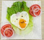 Love shaped fried eggs — Stock Photo