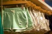 Womens shorts hanging in trendy boutique — Stockfoto