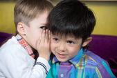 Boys are divided secret — Stock Photo