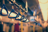 Handrails in a subway car — Stock Photo