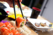 Sushi roll Philadelphia with chopstick — Stock Photo