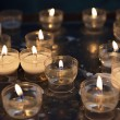 Firing candles in catholic church — Stock Photo #55963697