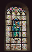Stained glass window in Saint-Martin Church with image of Saint Simon — Stock Photo