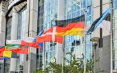Flags on front of European Parliament building in Brussels, Belgium — Stock Photo