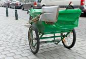 Typical green pushcart of municipal street cleaning service in Brussels — Stock Photo