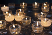 Firing candles in catholic church — Stock Photo