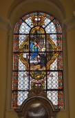 Stained glass window in Collegiate church of Saint-Denis of Liege — Stock Photo