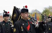 Poppy Parade defile moves to Porte de Menin or Gates of Menin from Grand Place — Stock Photo