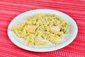 Salmon with pasta, broccoli and cream sauce — Stock Photo