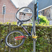 Bicycle parked in a special way in Leuven, Belgium - joke — Stock Photo
