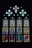 Stained glass window in Saint Hermes church with images of saints — Stock Photo
