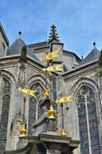 Fountain built in 1779 on front of collegiate church Saint-Waudru in Mons, Belgium — Stock Photo